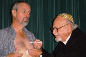 Shylock (Jerry Duckor) about to take his pound of flesh