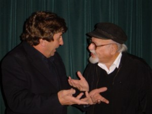 Tubal (Michael McDonald) speaks to Shylock